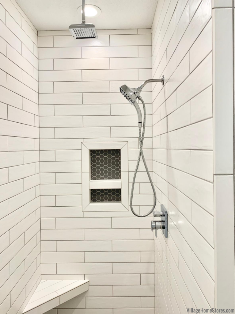 Elongated Brickwall 4 inch by 20 inch matte white tile as shower walls with gray grout. Custom shower tile by Village Home Stores.