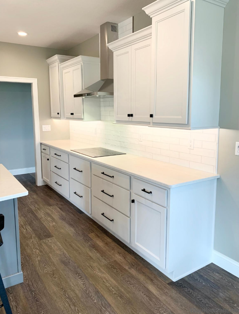 White kitchen design with lots of large drawer storage. Design and products by Village Home Stores for Hazelwood Homes.