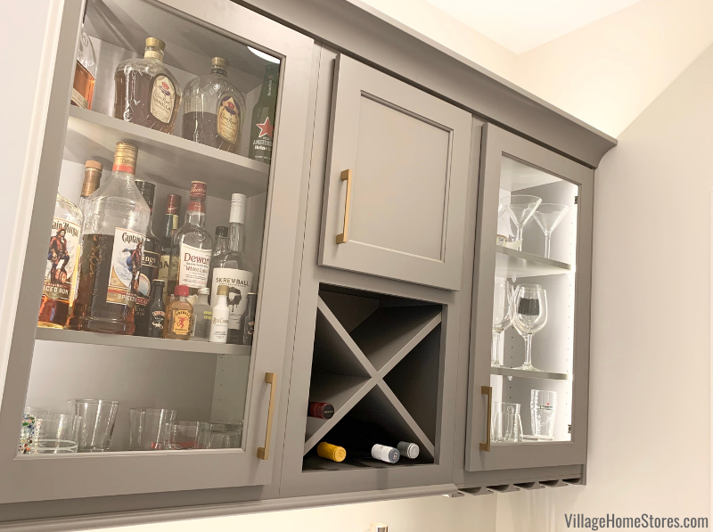 Bar cabinet with glass doors just off of a newly remodeled kitchen in Davenport, Iowa. Fog Gray cabinetry and X shaped wine storage featured.