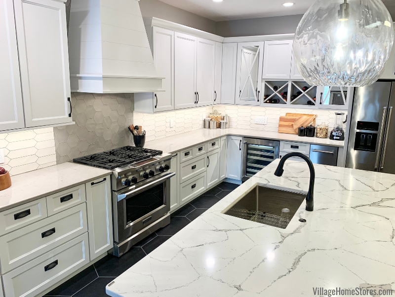 White cabinet kitchen with geometric tile surfaces and Cambria Harrogate and St. Giles quartz designs.