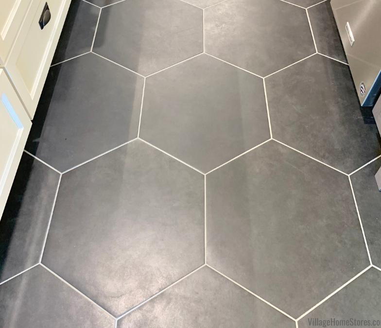 matte black hexagon shaped floor tile installed in a white painted kitchen