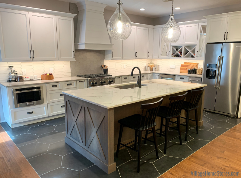 Koch cabinet kitchen in white paint with rift oak silverwood island and cambria quartz tops
