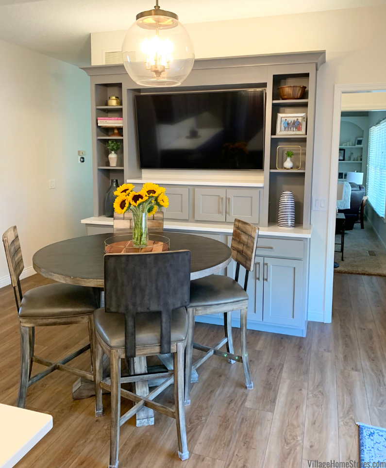 Custom TV hutch in a remodeled kitchen with pub height kitchen table.