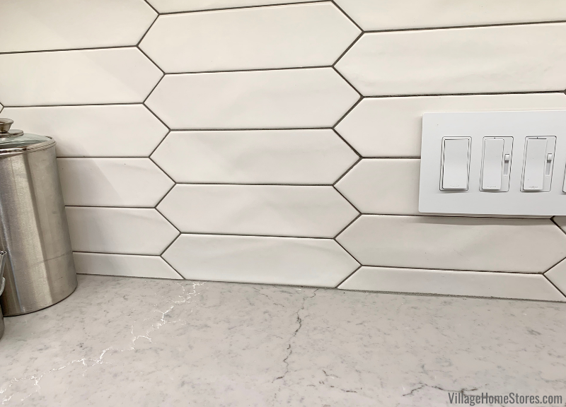 Matte white crayon shaped wall tile in kitchen installed with gray grout