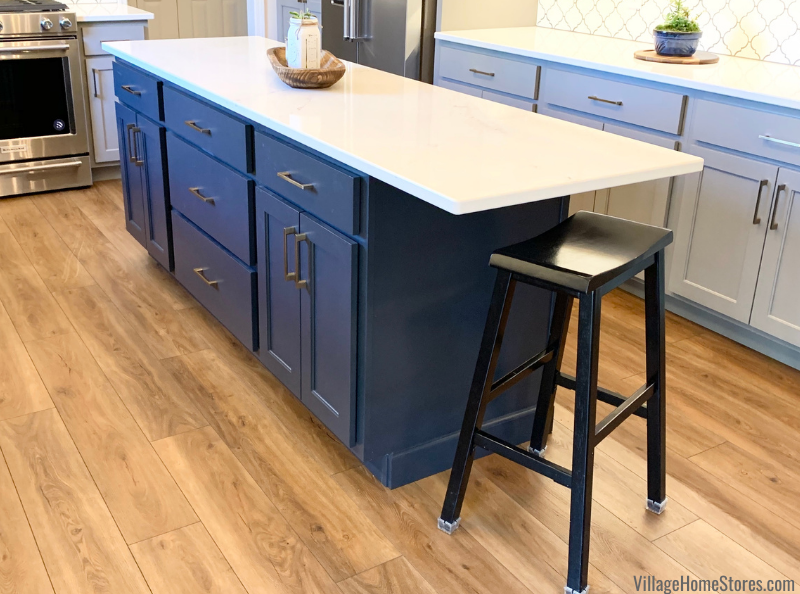 Shallow kitchen island with overhang space for one stool.