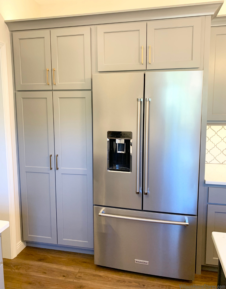 Tall pantry cabinet and KitchenAid french door fridge in a remodeled Davenport, Iowa kitchen by Village Home Stores.