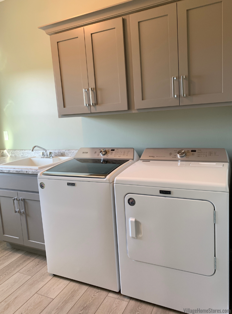 Laundry room with large capacity Maytag laundry pair and Koch Express cabinets painted in the Fog finish.