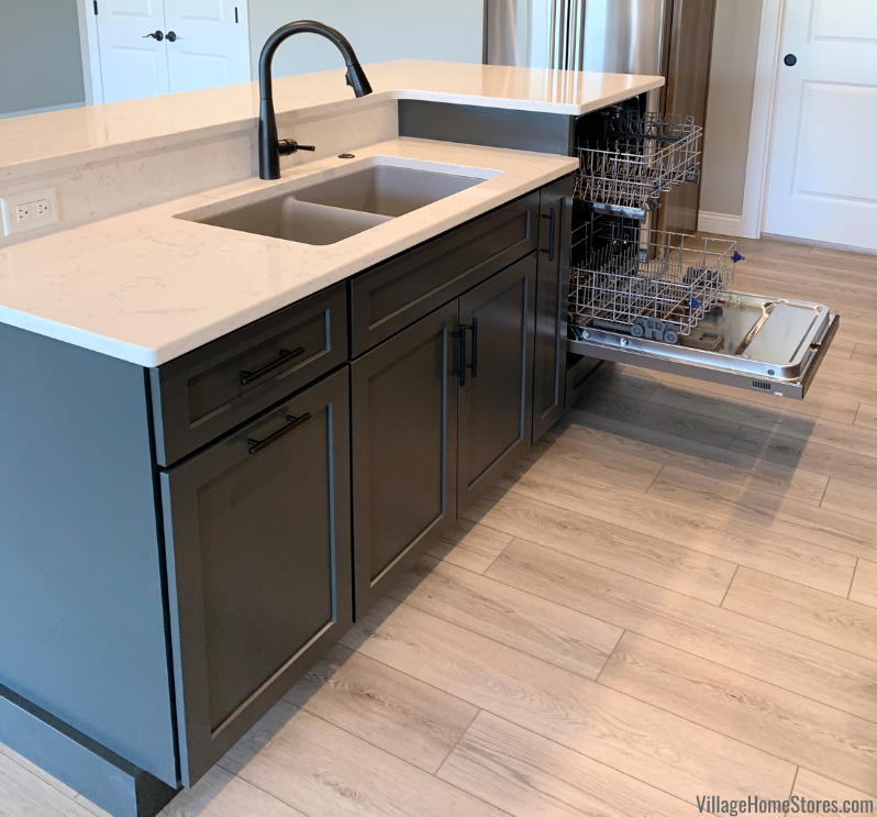 Two level kitchen island with sink and raised dishwasher. Whirlpool dishwasher in Graphite painted island with Cambria Torquay quartz tops.