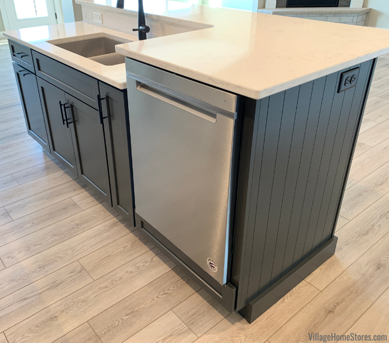 Kitchen island with raised dishwasher and countertop.