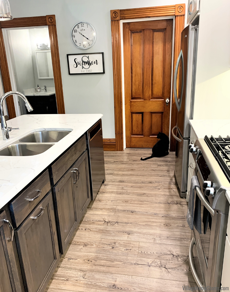 Kitchen renovation in Geneseo, IL with original trim and moldings and new COREtec luxury vinyl plank floors with black cat