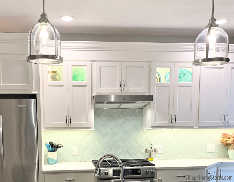 Pendant lights above kitchen island. Quorum banded dome shaped lights from Village Home Stores.