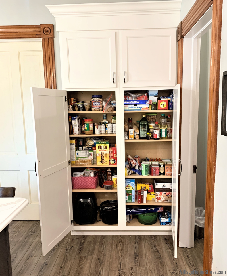 Kitchen with tall shallow pantry cabinet. Koch Ivory white painted cabinet by Village Home Stores.