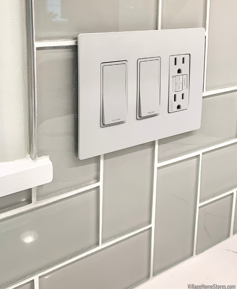 Wall switches and outlets on Daltile 3 x 6 Feather White backsplash tile in a Geneseo, IL kitchen.
