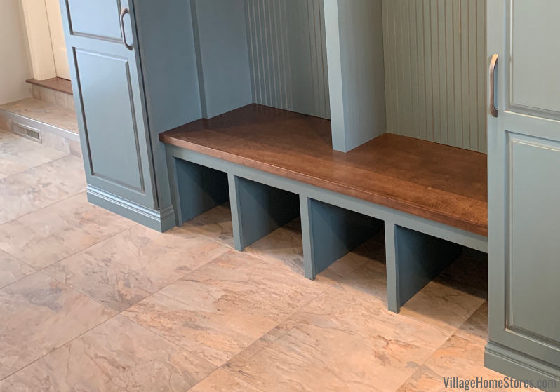 Frontier stain on Birch wood from Koch Cabinetry shown on a wood countertop used as bench seat. Cabinets and remodel by Village Home Stores.