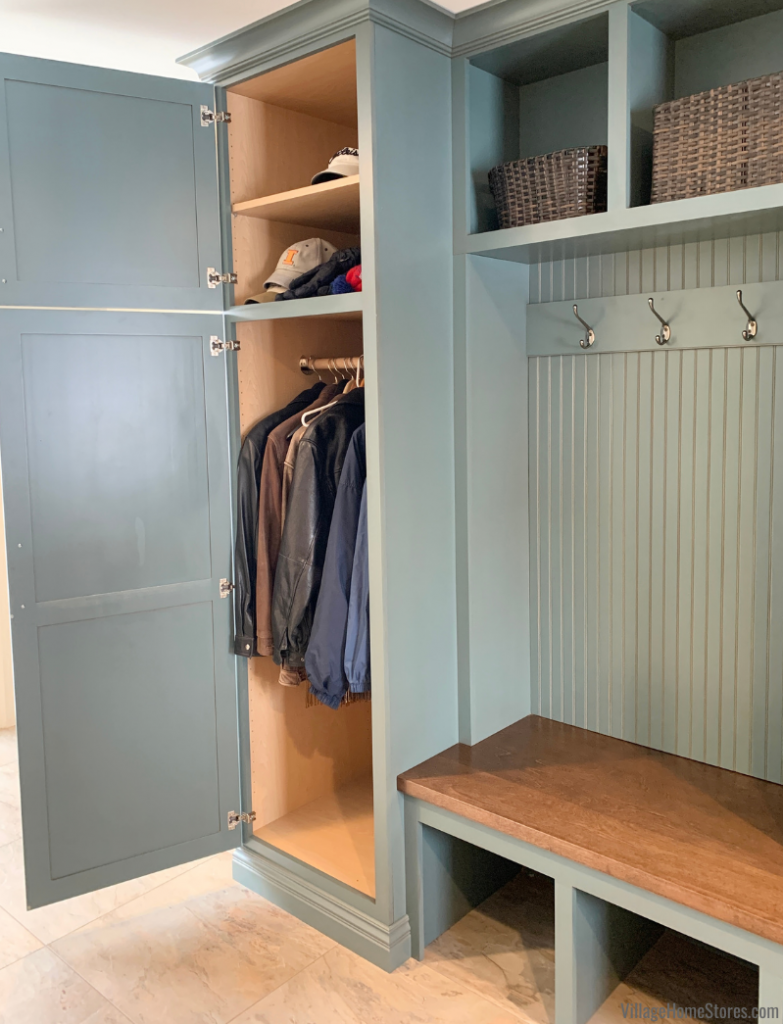 Deep coat storage cabinet in mudroom bench area. Village Home Stores converted an existing closet into this new bench seat.