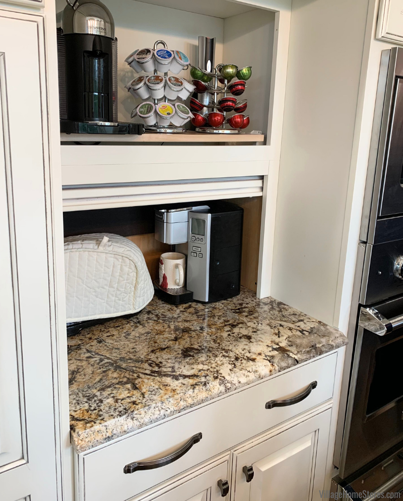 Coffee station cabinet with roll out tray and appliance garage