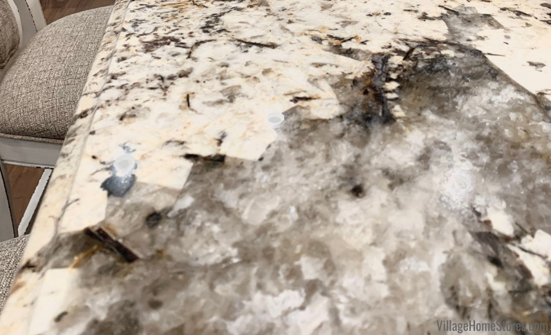 Pockets of quartz in Caravelas Gold Granite counters. Natural stone is a gorgeous and unique investment for your kitchen countertops.