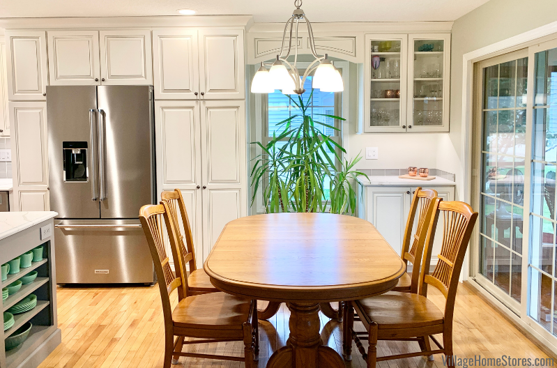 Kitchen design with single island, bar area, and room for a kitchen table. Kitchen design and materials with complete start to finish remodel by Village Home Stores.