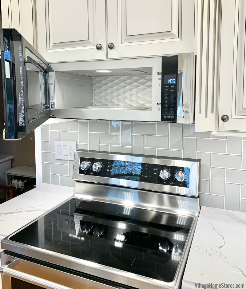 KitchenAid low profile microwave hood in a Geneseo Illinois home remodeled from start to finish by Village Home Stores.