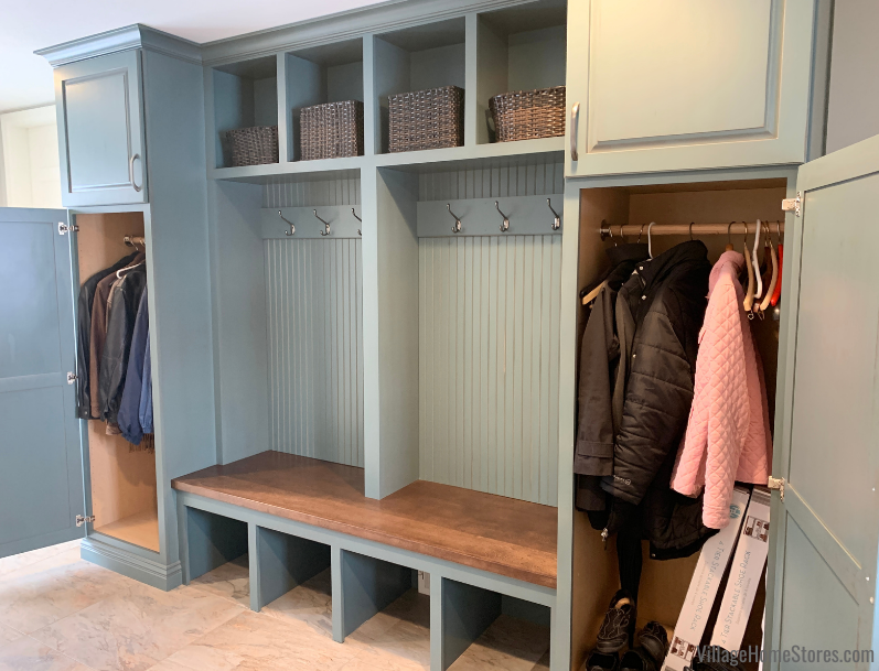 Mudroom bench with storage in Capri Drift finish by Koch Cabinetry. Cabinetry and remodel in Rock Island Quad Cities home by Village Home Stores.