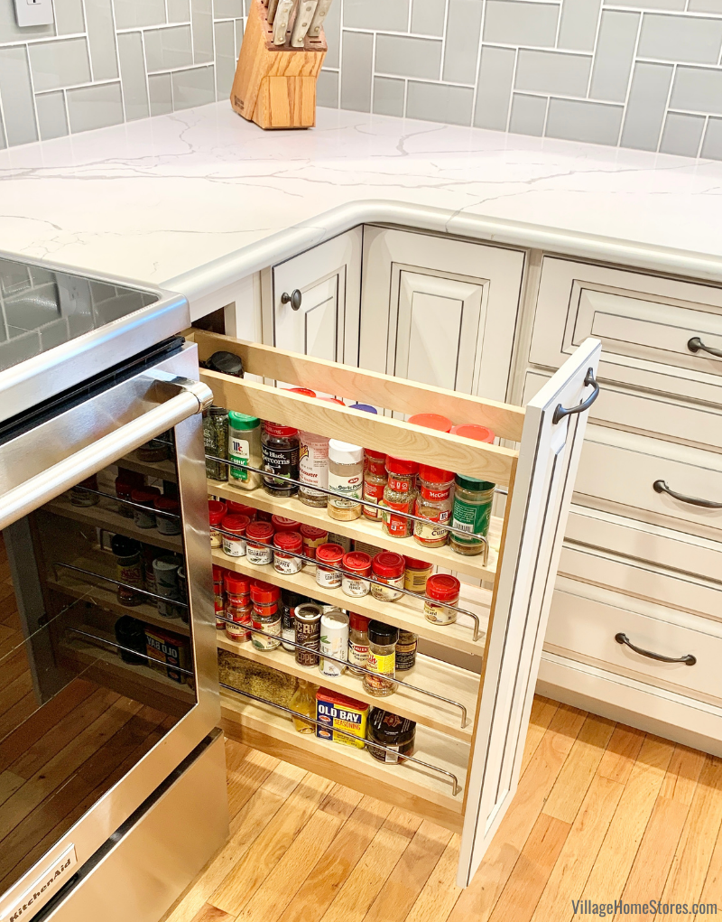 Pull out spice rack cabinet next to kitchen range in a Geneseo Illinois home remodeled from start to finish by Village Home Stores.