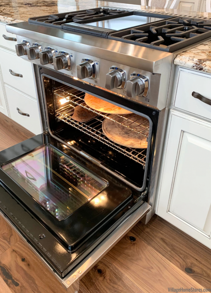 Viking 7 Series Dual Fuel range with door open and shelves shown with baking stones.