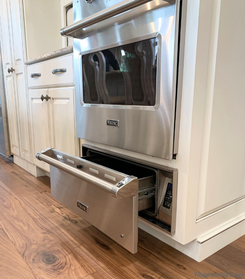 Stainless Steel Viking 27 inch warming drawer installed in a tall cabinet