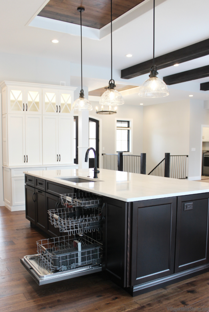 Kitchen island with 3 rack Kitchen Aid dishwasher and Cambria Quartz counters.