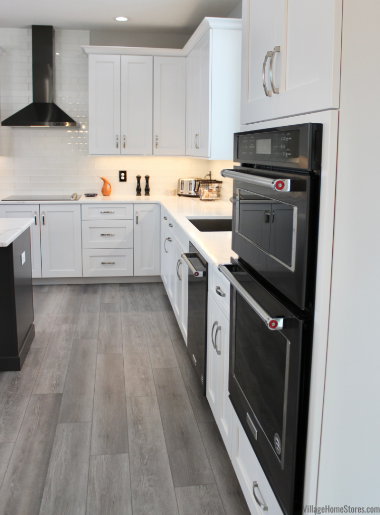 Black Stainless Steel kitchen appliances by KitchenAid in a White painted kitchen from Village Home Stores.