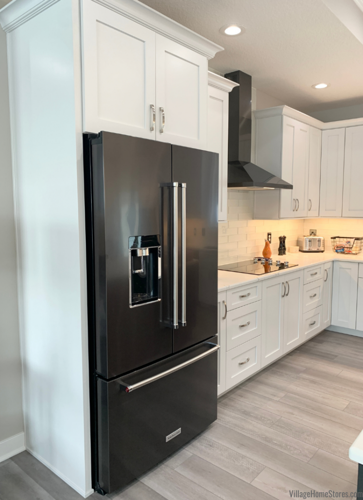 Black Stainless Steel counter-depth french door refrigerator by Kitchen Aid in a LeCalire, Iowa home. Appliances and kitchen by Village Home Stores for Wood Builders of the Quad Cities.