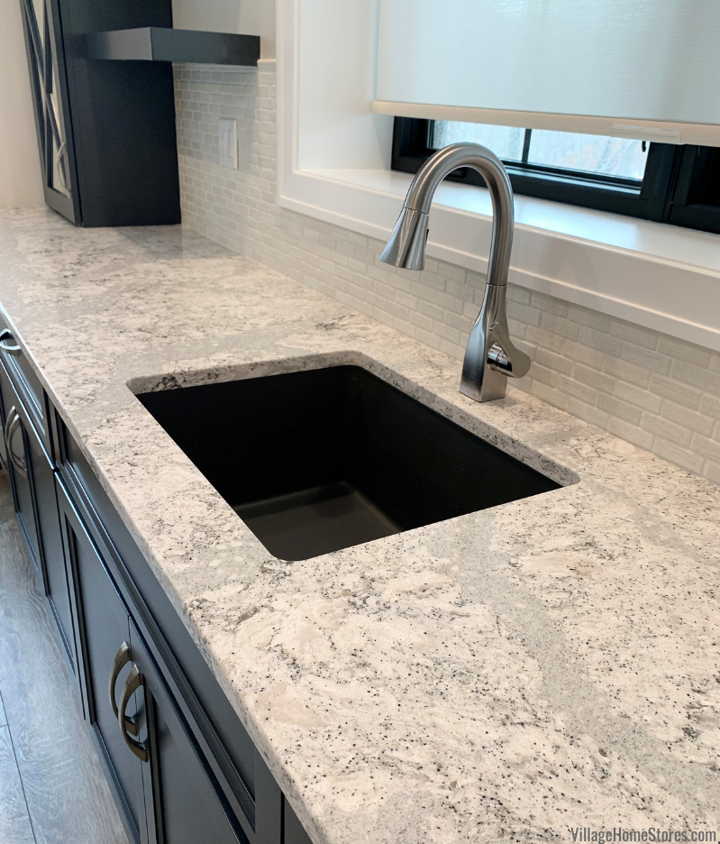 black bar sink undermounted to Cambria Summerhill quartz countertops on blue painted bar cabinets