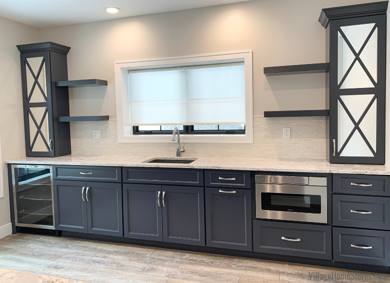 Home bar in painted Charcoal Blue with Cambria Summerhill Quartz counters and mirrored cabinet doors.