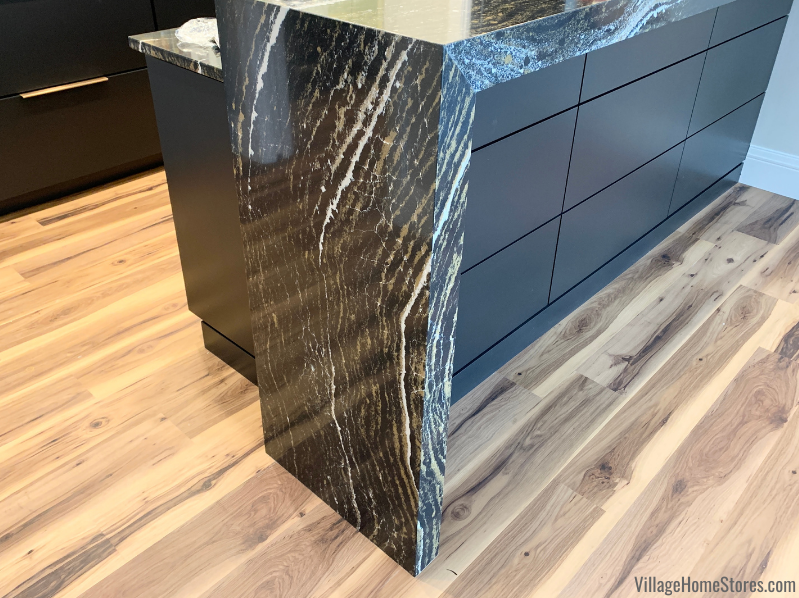 Extra Thick waterfalling Cambria Quartz counters in Golden Dragon design. Bar cabinetry and countertops by Village Home Stores.
