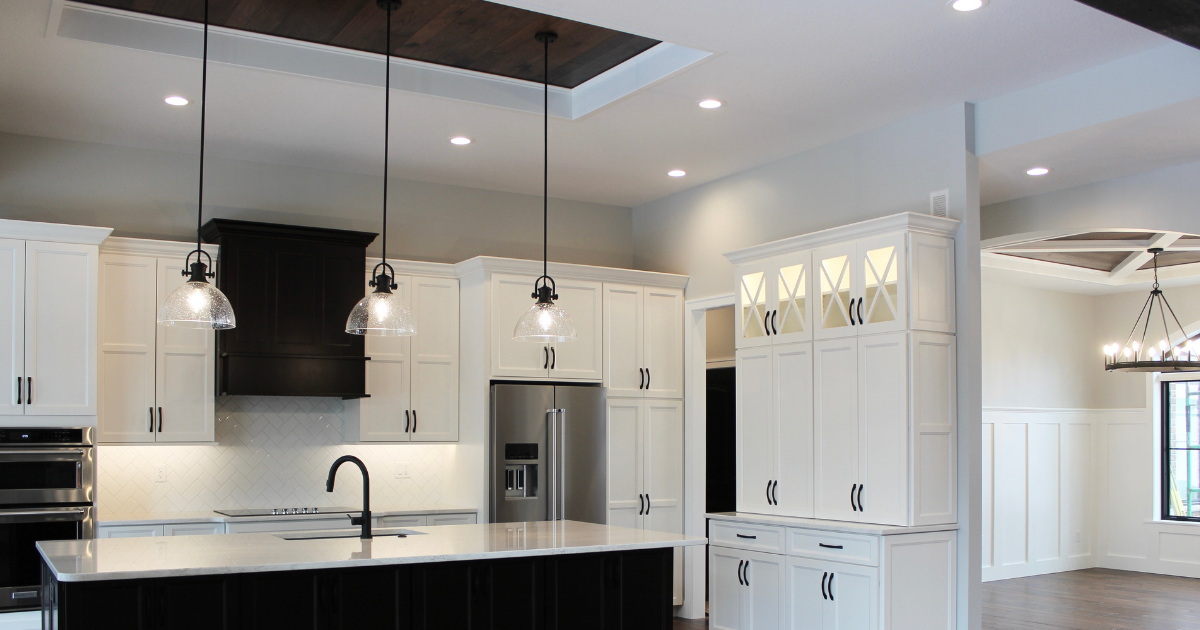 white and dark java stained kitchen with pendant lighting