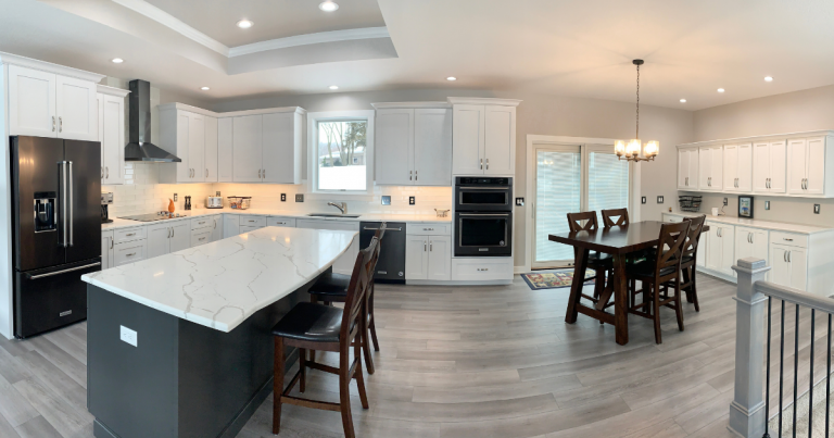 great room kitchen with seating at island and dining table