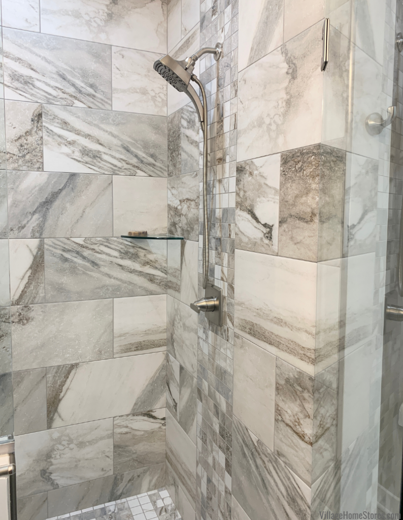 """Shower tile design with 12 x 24"""" tiles and mosaic floor and wall accent. Tile by Village Home Stores for a new home built in LeClaire, Iowa by Wood Builders."""