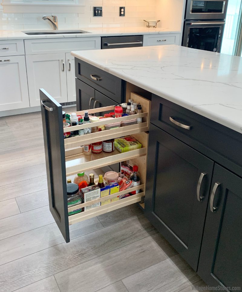 Spice cabinet pullout shown open in Wynnbrooke Cabinetry kitchen island Denali door and dark gray Pewter paint.