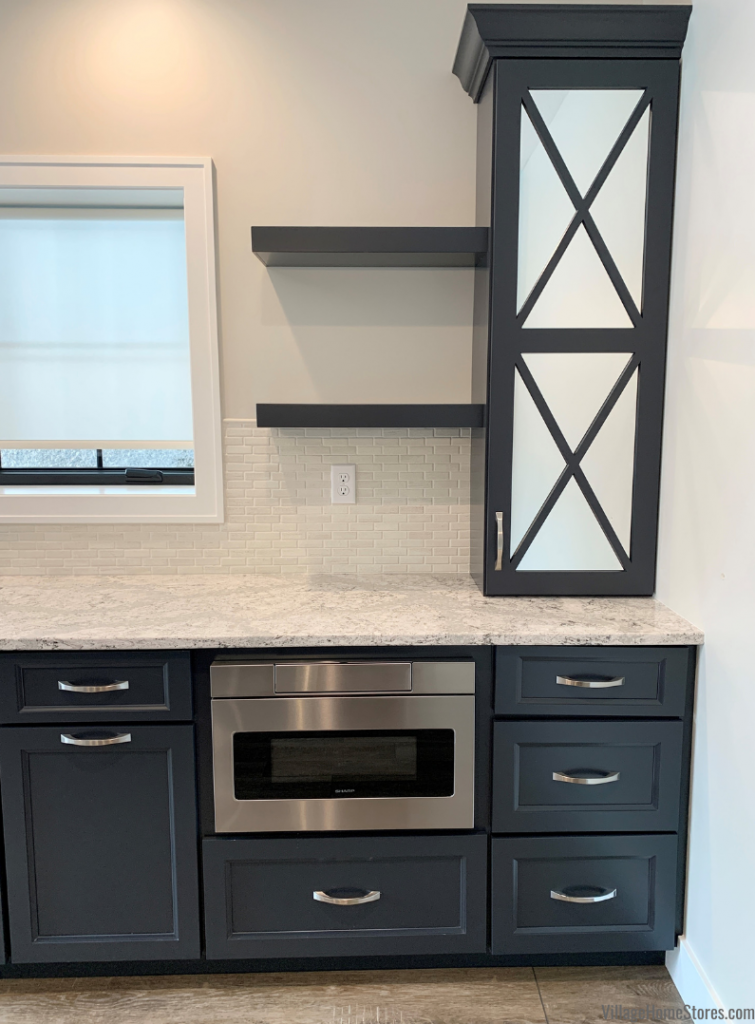 Blue painted cabinets with floating shelves and mirror cabinet inserts with X design. Stainless Steel Sharp microwave drawer installed in a cabinet.