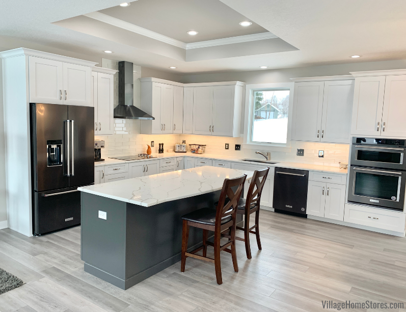 Wynnbrooke Cabinetry installed in a Quad Cities area kitchen by Village Home Stores in White and Pewter finishes with Black Stainless Appliances.