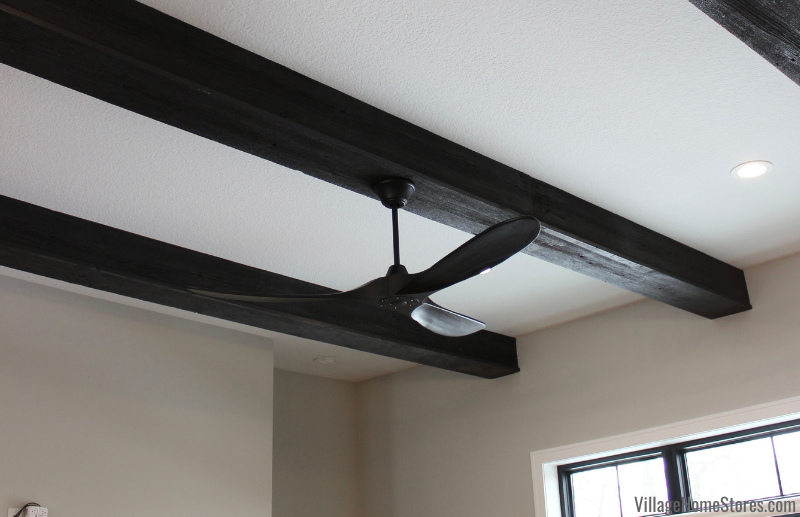 Maverick Matte Black ceiling fan on wood beam. Fan by Village Home Stores for Hazelwood Homes of the Quad Cities.