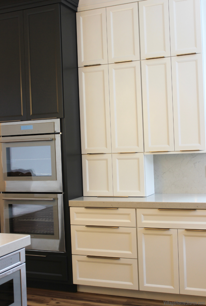 Painted kitchen cabinets in Iron Ore and Super White paint. Kitchen with Wall Ovens in Iowa Quad Cities.
