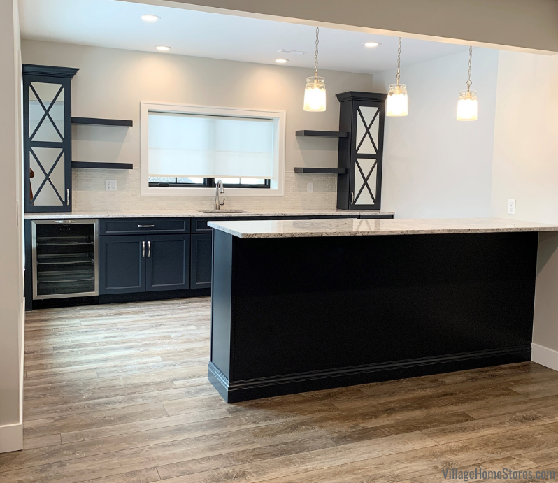 Lower Level bar in painted Charcoal Blue with Cambria Summerhill Quartz counters and mirrored cabinet doors.