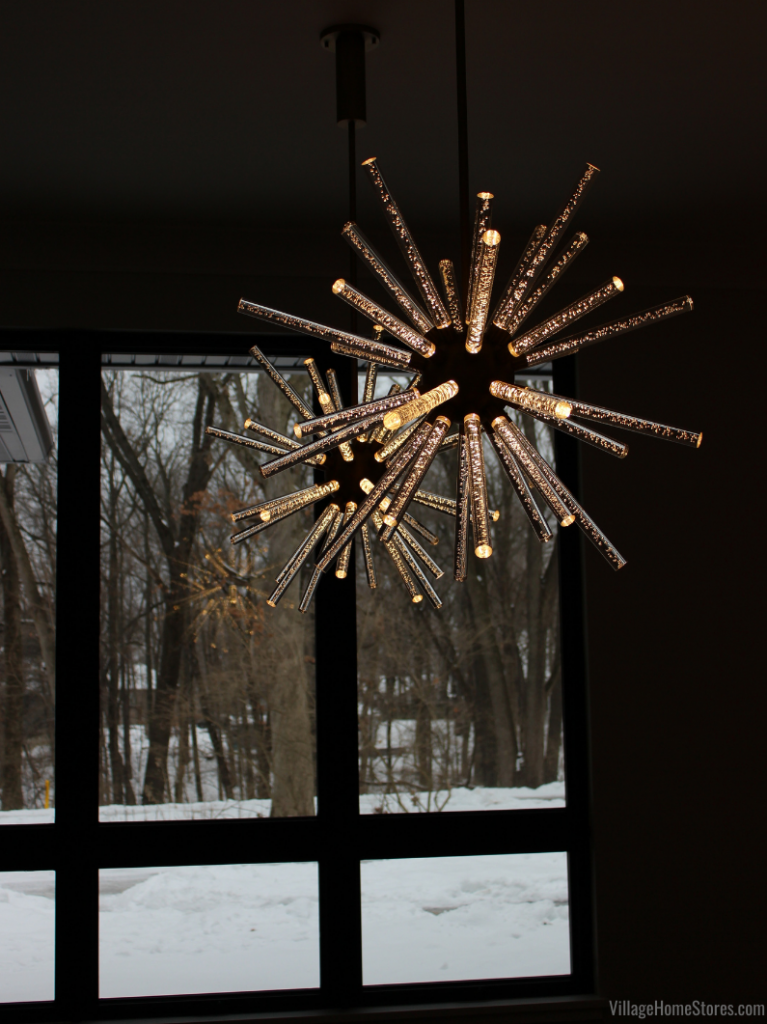 "A pair of LED bubble chandeliers hang in a Bettendorf Iowa Dining Room. These Kuzco ""Astro"" lights are a clear acrylic and from Village Home Stores."