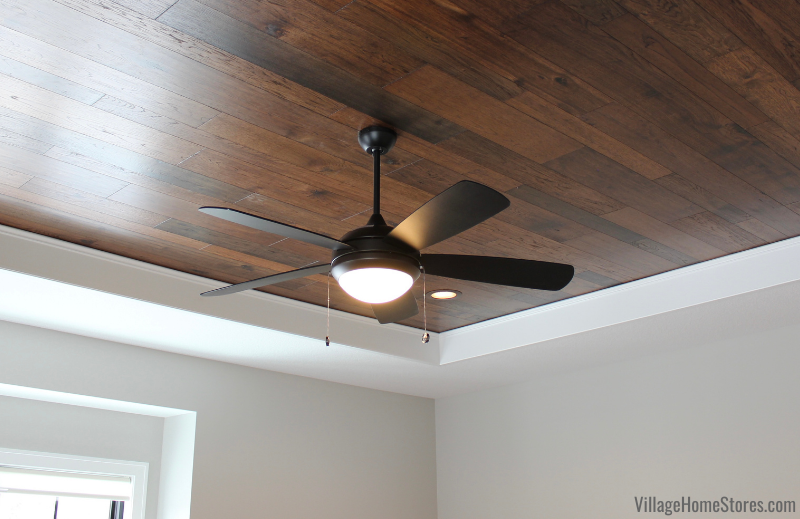 Wood ceiling in bedroom with LED fan. Flooring and ceiling fan by Village Home Stores for Hazelwood Homes of the Quad Cities.