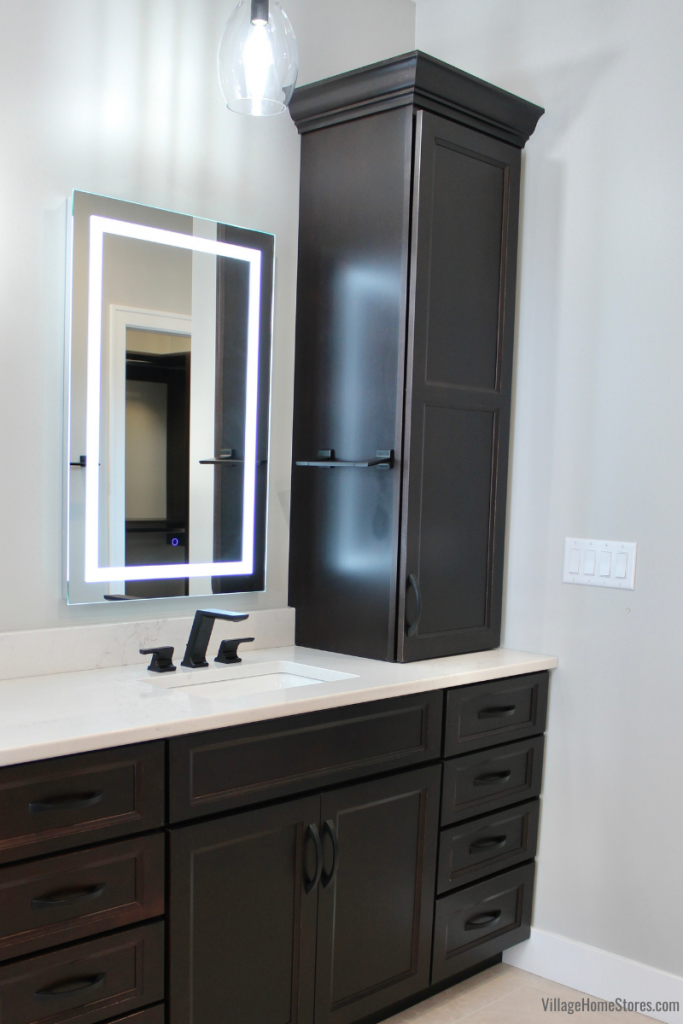 """Java stained Koch Cabinetry in Primary bathroom with KRUGG 24"""" x 36"""" LED mirrors."""