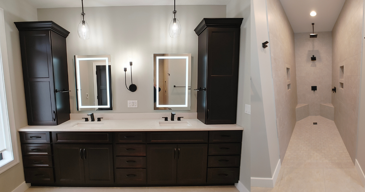 Primary bathroom with two sinks, Java stained Koch Cabinetry, LED-lit mirrors, and tiled walk in shower.