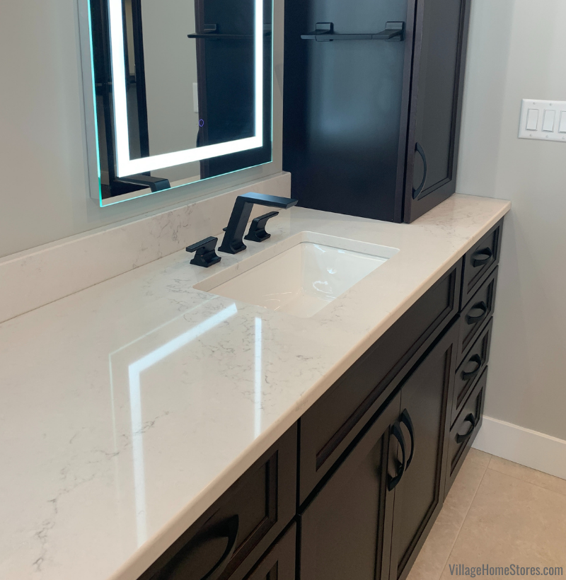 Montauk quartz counters installed in the primary bathroom of a new home built in Coal Valley, Illinois. Village Home Stores for Hazelwood Homes.