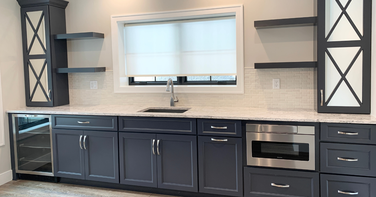 blue cabinet bar with floating shelves and microwave drawer
