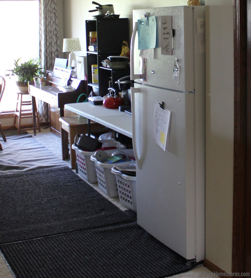 Example of a temporary kitchen setup with folding table and laundry tubs during a remodel by Village Home Stores.