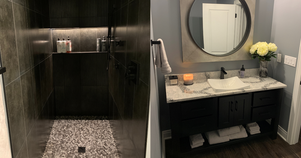 Bathroom with dark tiled shower and furniture style vanity.